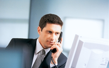 Businessman with telephone and computer in an office