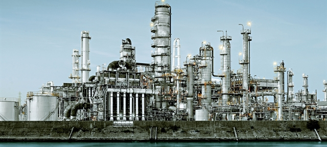 Oil refineries line a river in Yokkaichi, Japan. The city has been a center for the chemical industry since the 1930's.